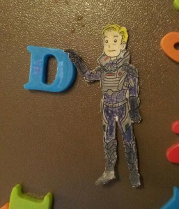 The David cut-out touches a plastic magnet D
