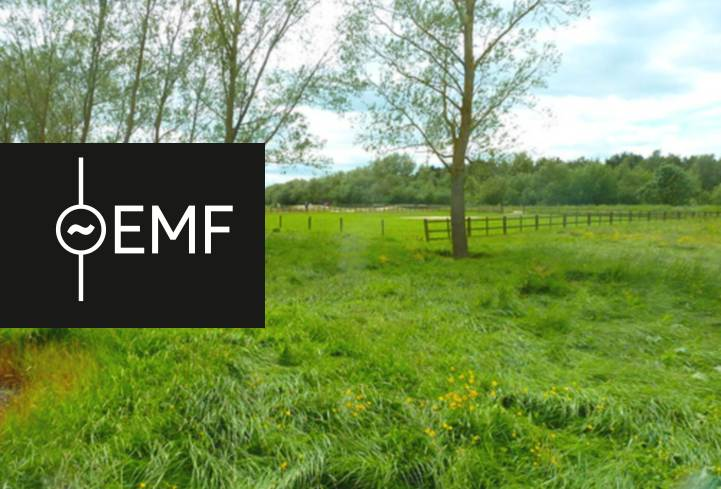 EMF Camp logo and a photo of the field